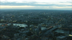 Aerial view of illuminated London Eye and bridges over the River Thames UK Stock Footage