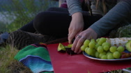 Closeup Of Young Woman Slicing An Avocado, Shares A Slice With Her Friend Stock Footage