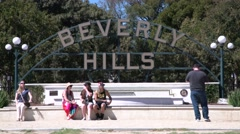 Beverly Hills sign and tourist Stock Footage