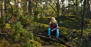 Child girl 8-9 years hiker on a halt in forest Stock Footage