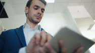 Man Working on Tablet Computer Stock Footage