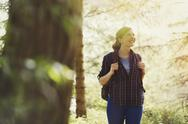 Smiling woman hiking in woods Stock Photos