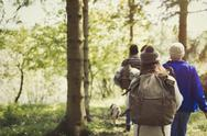 Friends backpacking hiking in woods Stock Photos