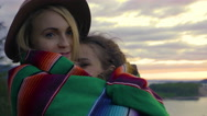 Young Woman Wraps Her Friend In Her Blanket At Scenic Overlook Stock Footage