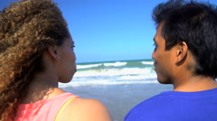 Young smiling multi ethnic couple in colorful sportswear enjoying togetherness Stock Footage