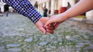 Couple walking holding hands closeup and then break them in slow motion Stock Footage
