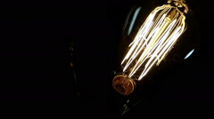 An old lamp turns on and off with vintage bulb. Stock Footage