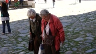 Old aged senior women tourists walking smiling in good mood in courtyard Stock Footage