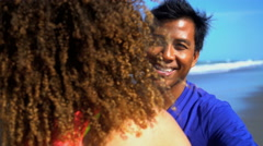 Young loving smiling multi ethnic couple in colorful sportswear embracing  Stock Footage
