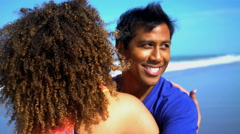 Happy smiling African American woman with Latin American man relaxing  Stock Footage