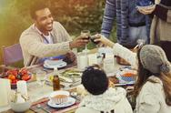 Couple toasting wine glasses at patio table lunch Stock Photos