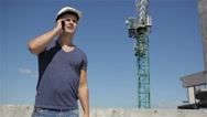 Builder calls somebody on the phone Stock Footage