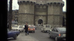 1978: european style castle city wall entrance automobile traffic FRANCE Stock Footage