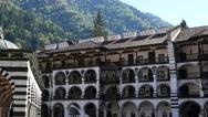 Beautiful building of male friary Rila Monastery of Bulgarian church Stock Footage