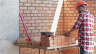 Builder shifts bricks at the building under construction Stock Footage