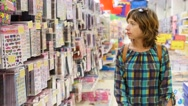 Woman shopping looking at goods at big kid store merchandise for children Stock Footage