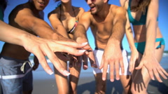 Portrait of young multi ethnic people wearing swimsuits and sunglasses relaxing Stock Footage