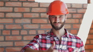 Male builder shows his thumb up Stock Footage