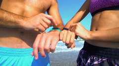 Young active multi ethnic male and female checking sport watch  Stock Footage