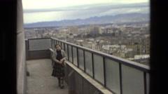 1978: young girl wearing plaid skirt walking across bridge Stock Footage