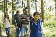 Friends hiking in woods Stock Photos