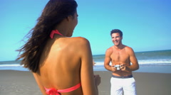 Young loving multi ethnic couple in swimwear having fun taking a photo  Stock Footage