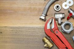 Thermostatic valve and plumber  tools on wooden background Stock Photos
