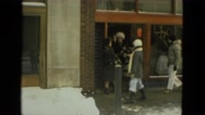 1978: stylish fashion cold weather warm clothes outside retail store business Stock Footage