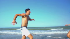 Young smiling multi ethnic male and female wearing swimsuits enjoying Stock Footage
