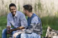 Smiling men talking outdoors Stock Photos