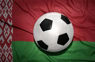 Black and white football ball on the national flag of belarus Stock Photos