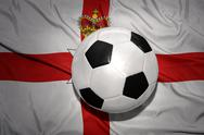 Black and white football ball on the national flag of northern ireland Stock Photos