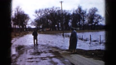 1960: flooding in road WAUCONDA, ILLINOIS Stock Footage