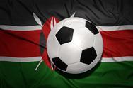 Black and white football ball on the national flag of kenya Stock Photos