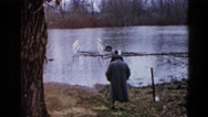 1960: man and woman walking to waters edge WAUCONDA, ILLINOIS Stock Footage