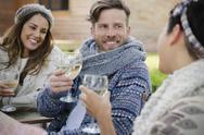 Smiling friends drinking wine on patio Stock Photos