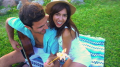 Portrait of multi ethnic couple making video diary and playing the guitar  Stock Footage