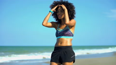 Young active African American female with afro hair running and using watches Stock Footage