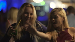 Attractive flirty blondes moving sexy bodies to music and having fun at party Stock Footage
