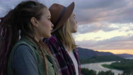 Young Women Look Out At View, Enjoy Sunset Together, Turn And Smile At Camera Stock Footage