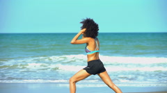 Young active African American female keeping fit and healthy stretching  Stock Footage