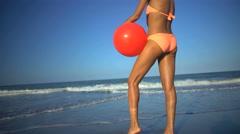 Attractive young slim African American woman in bikini posing on the beach Stock Footage