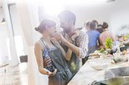 Playful couple enjoying cooking class in kitchen Stock Photos
