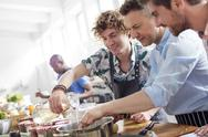 Male students in cooking class kitchen Stock Photos