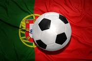 Black and white football ball on the national flag of portugal Stock Photos