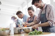 Couple enjoying cooking class in kitchen Stock Photos