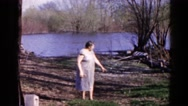 1960: farmer's wife going down to the river to fetch water WAUCONDA, ILLINOIS Stock Footage