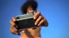 Attractive African American woman in swimwear having fun taking selfie  Stock Footage