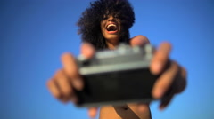Young attractive African American girl in swimsuit making video diary online  Stock Footage