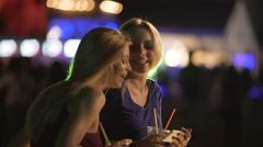 Happy young women posing for selfie in dance floor, lights flaring in nightclub Stock Footage